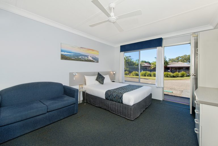 bedroom with sofa is just located along the motel road